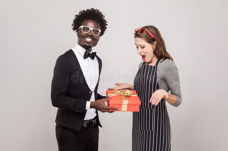 Proud african man gives a gift for St. Valentine`s Day stock photos