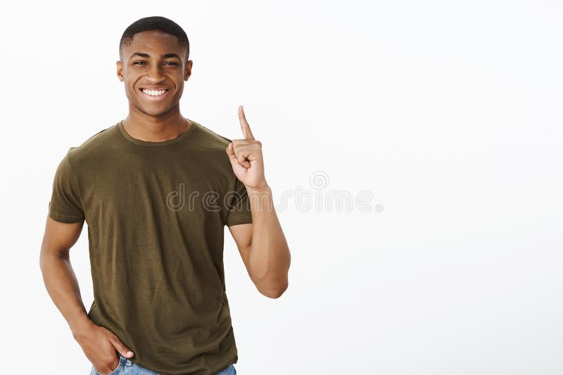Proud being number one in company. Portrait of cheerful and charismatic handsome african american male smiling broadly stock image