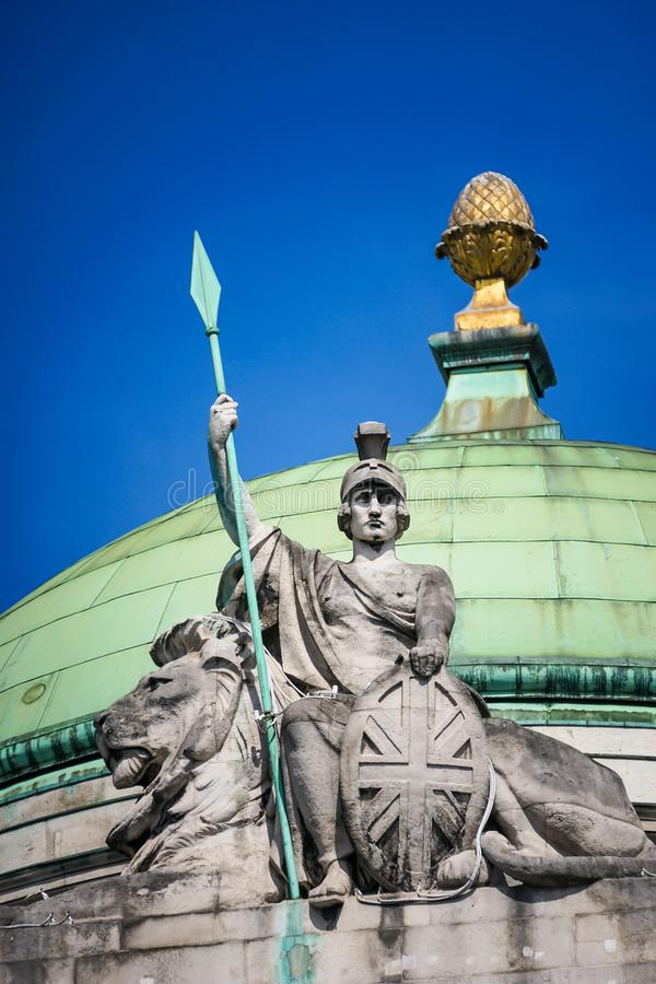 Proud Britannia, with spear in hand, union jack shield and lion. royalty free stock image