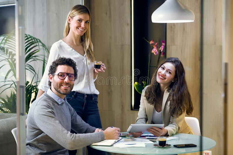 Proud business team participatinglooking at the camera on coworking place in advertising company. Portrait of proud business team participatinglooking at the royalty free stock photo