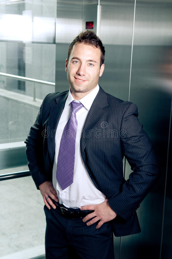 Proud businessman. Proud young businessman standing in the elevator royalty free stock photo
