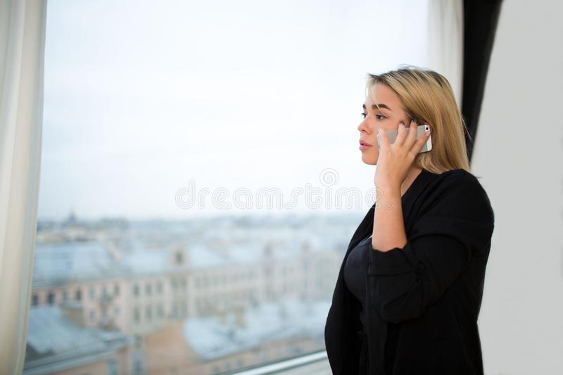 Proud CEO using mobile phone for call during work break royalty free stock image