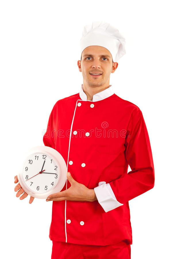Proud chef with clock. Proud chef man holding clock isolated on white background royalty free stock images