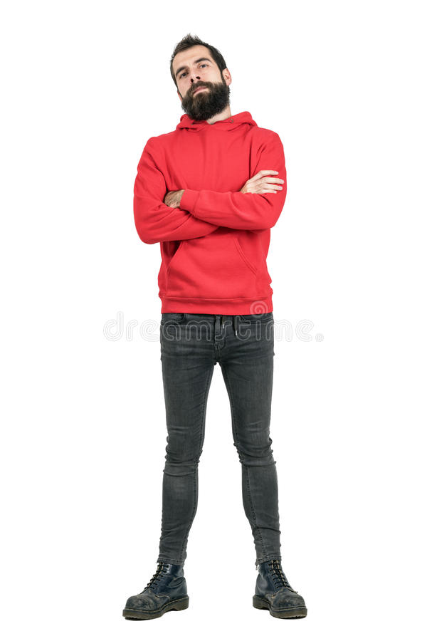 Proud confident bearded man in red hoodie with crossed arms looking at camera. Full body length portrait isolated over white studio background stock photos