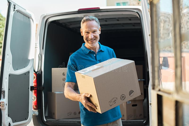 Delivery man holding parcel royalty free stock images