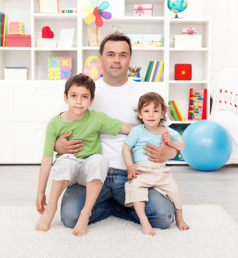 Proud father with his sons stock photo