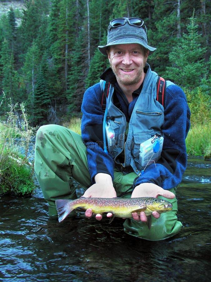 Proud fisherman stock photography
