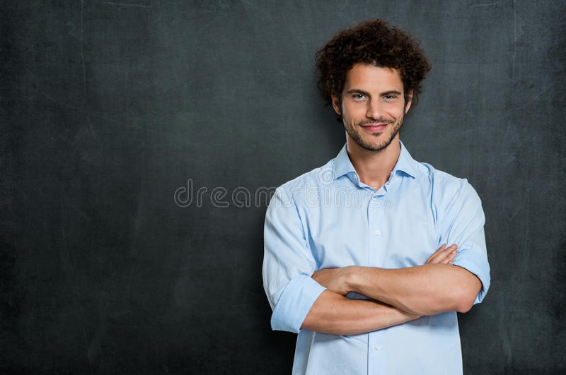 Proud Happy Businessman. Portrait Of Satisfied Young Man Over Gray Background royalty free stock photos