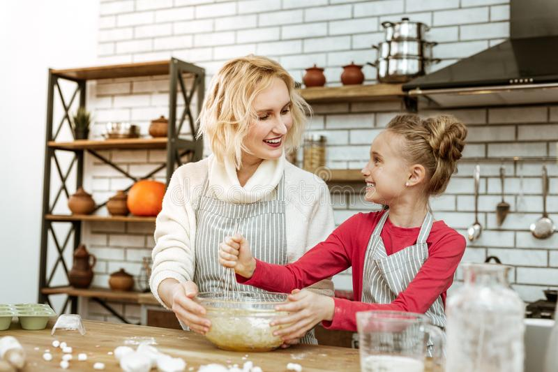 Proud happy lady looking on her smiling daughter royalty free stock image