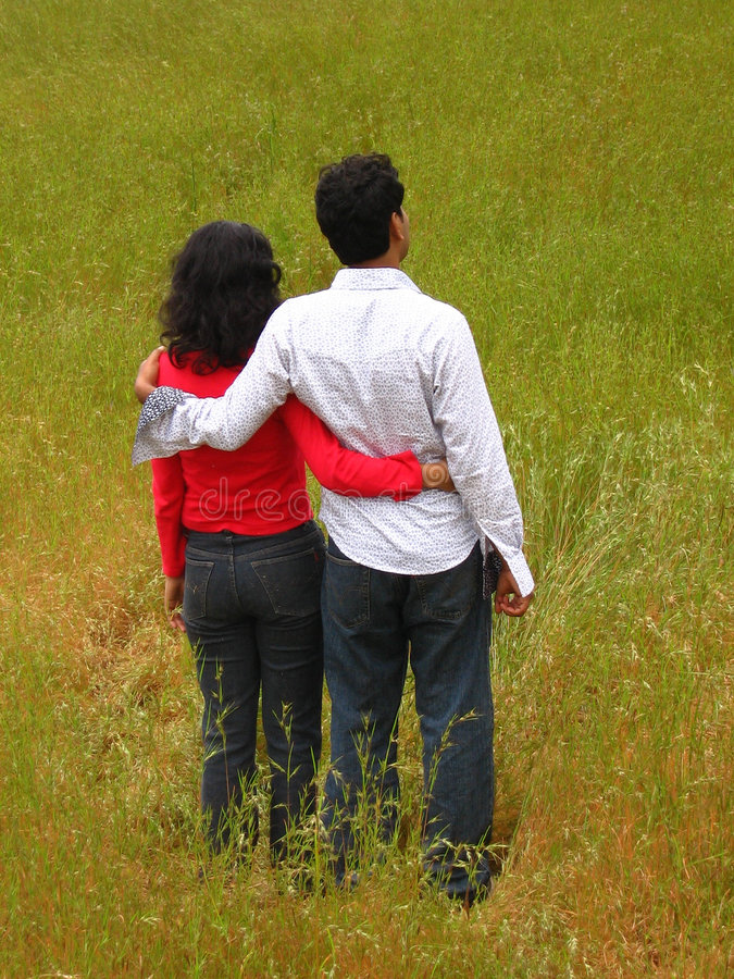 Proud Love. A couple waits in a fields of India royalty free stock photos