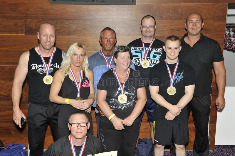 Proud male and female contestants showing their medals and trophy royalty free stock photos