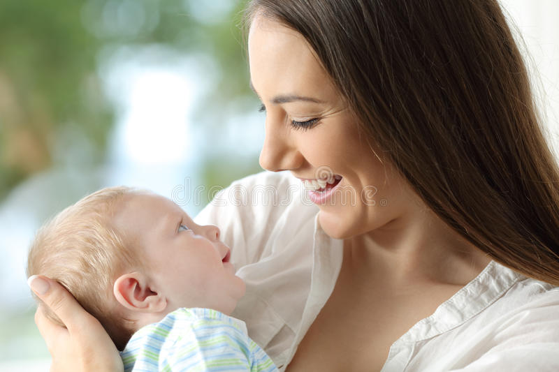 Proud mother holding her baby royalty free stock photography
