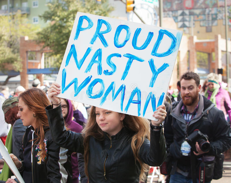 Proud Nasty Woman Holding Sign in Tuscon, Arizona royalty free stock photo