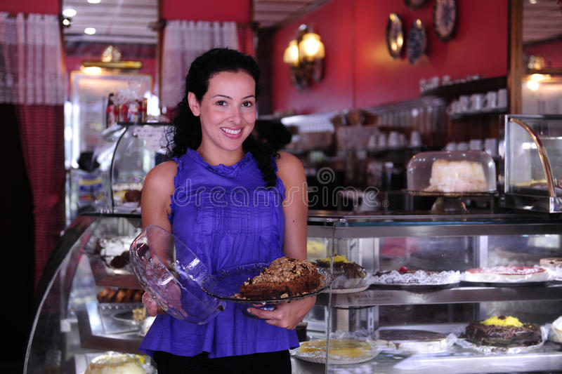 Proud owner of a cafe/ pastry shop stock image