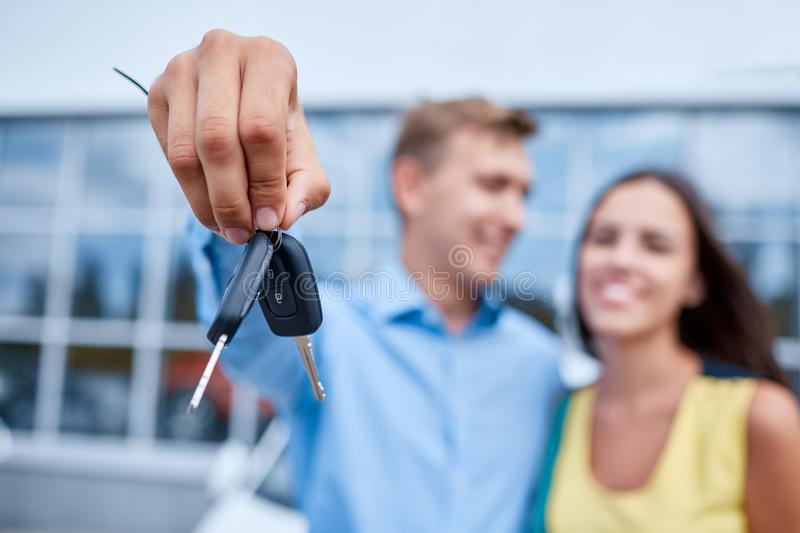 The family bought a new car in the showroom. The concept of buying a new car. royalty free stock image