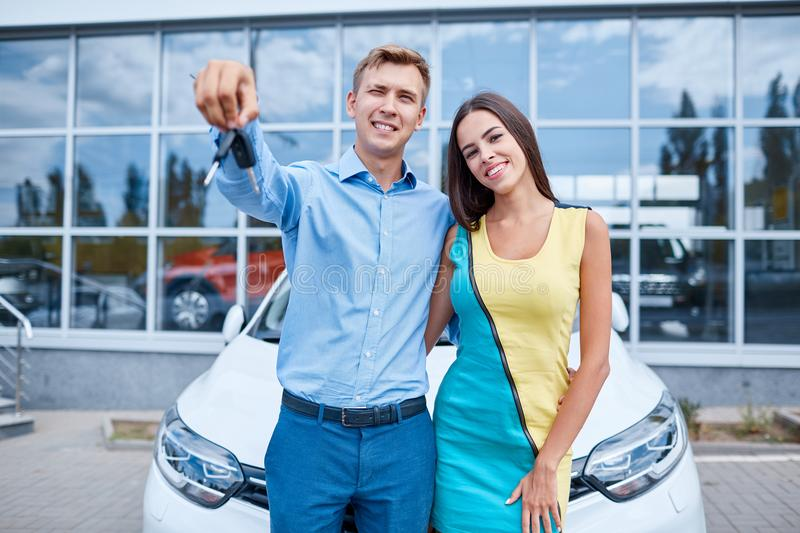 The family bought a new car in the showroom. The concept of buying a new car. stock image