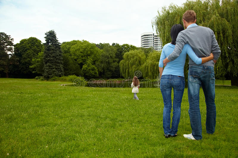 Proud parents. Parents looking after their daughter in a park stock photos