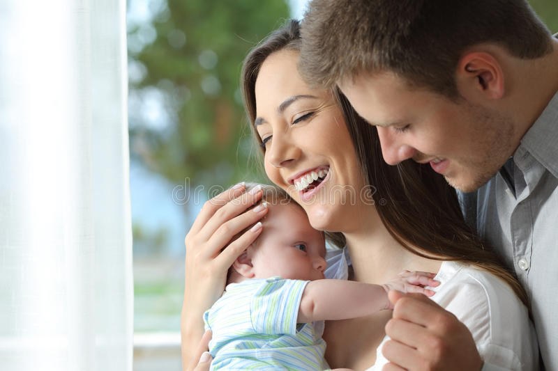Proud parents holding their baby royalty free stock photo