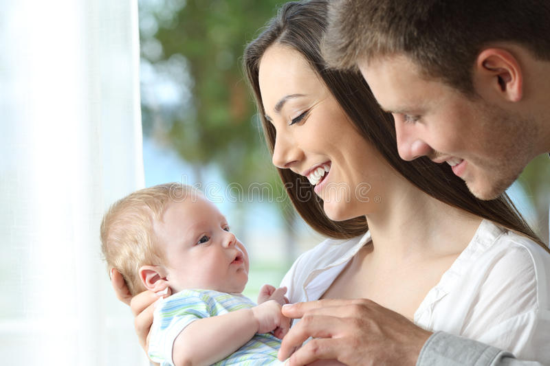 Proud parents playing with their baby stock photos