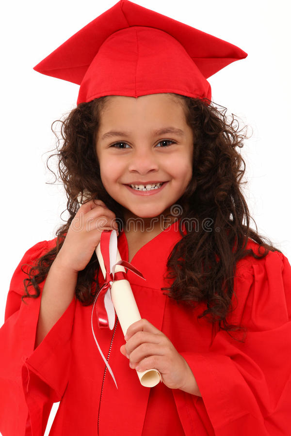 Proud Preschool Girl Graduate Child. Adorable 4 year old hispanic african american mixed girl in red graduation cap and gown with certificate diploma over white royalty free stock photography