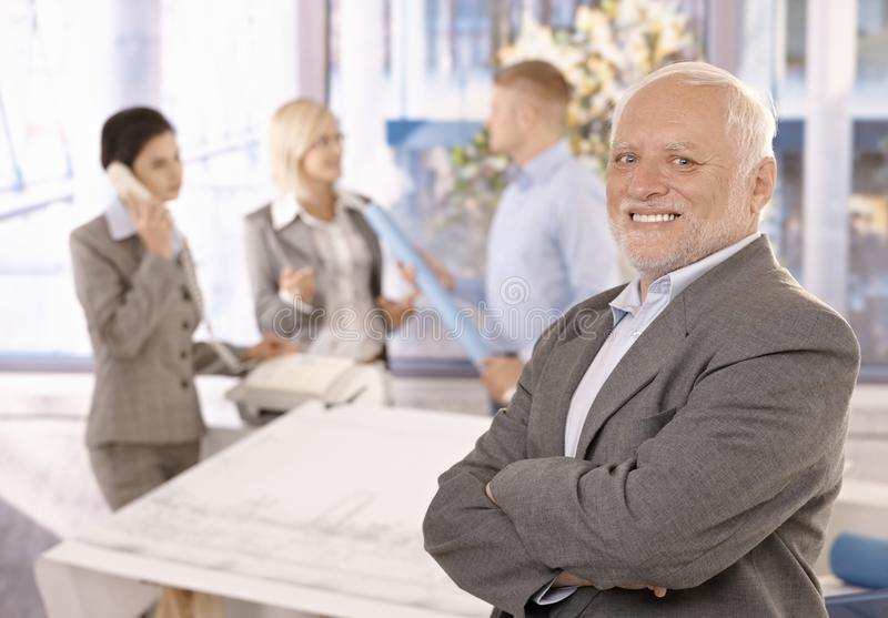 Download Proud Smiling Senior Businessman With Team Stock Image - Image of cheerful, creative: 18489949