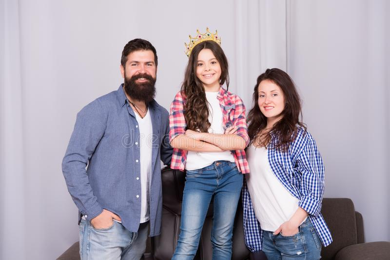 Proud with their small daughter. Childrens day. Father, mother and queen child. Happy family day. Bearded man and woman royalty free stock photos