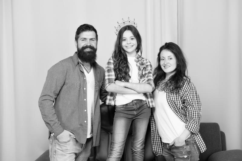 Proud with their small daughter. Childrens day. Father, mother and queen child. Happy family day. Bearded man and woman. Proud with their small daughter stock photos