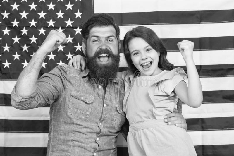 Proud to be americans. Happy american family celebrating Independence day. Bearded man and little child with winner. Proud to be americans. Happy american family royalty free stock photography