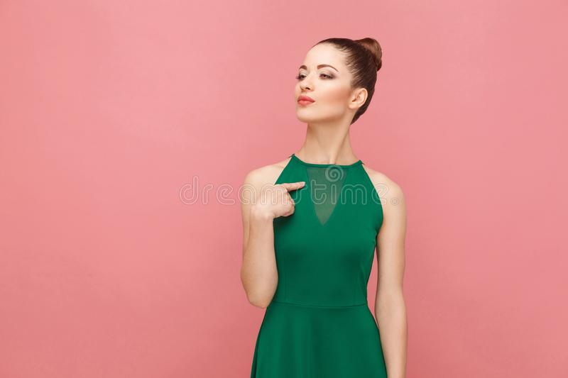 Proud woman pointing finger himself. Expression emotion and feelings concept. Studio shot, on pink background royalty free stock image