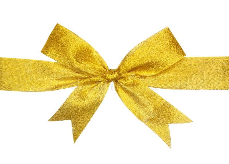 Proue de cadeau d'or d'isolement sur le blanc image stock
