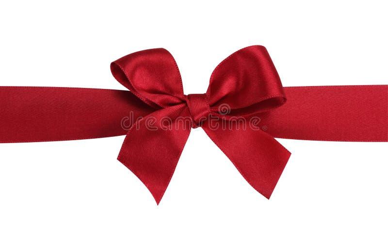 Proue rouge de cadeau avec la bande. image libre de droits