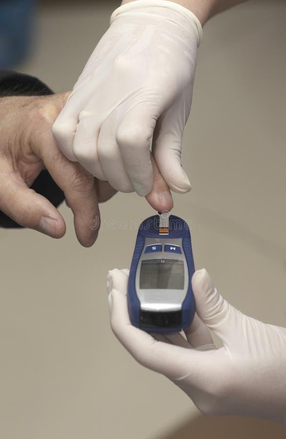 prov för medicin för laboratorium för hälsa för blodomsorgssockersjuka arkivfoto