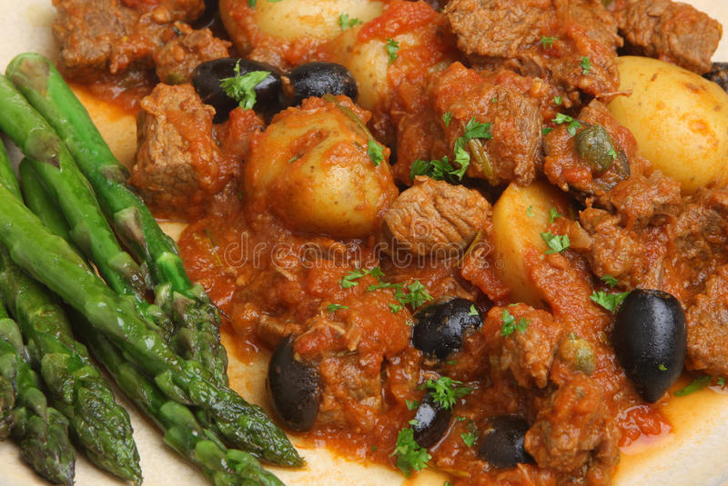 Provencal Beef Stew with Asparagus. Provencal beef stew served with asparagus stock image