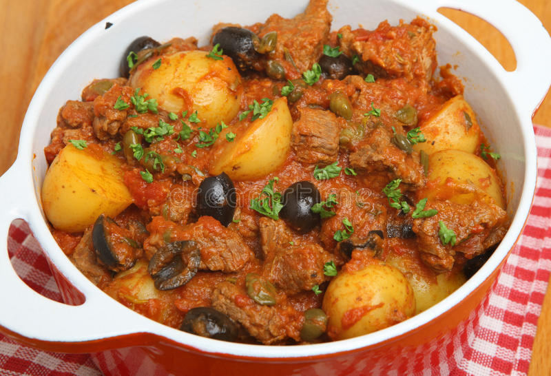 Provencal Beef Stew in Casserole Dish. Provencal beef stew with new potatoes royalty free stock photo