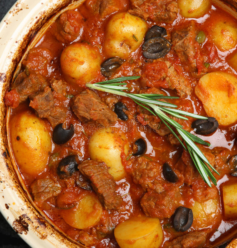 Provencal Beef Stew with New Potatoes. French beef stew with new potatoes and olives royalty free stock photos