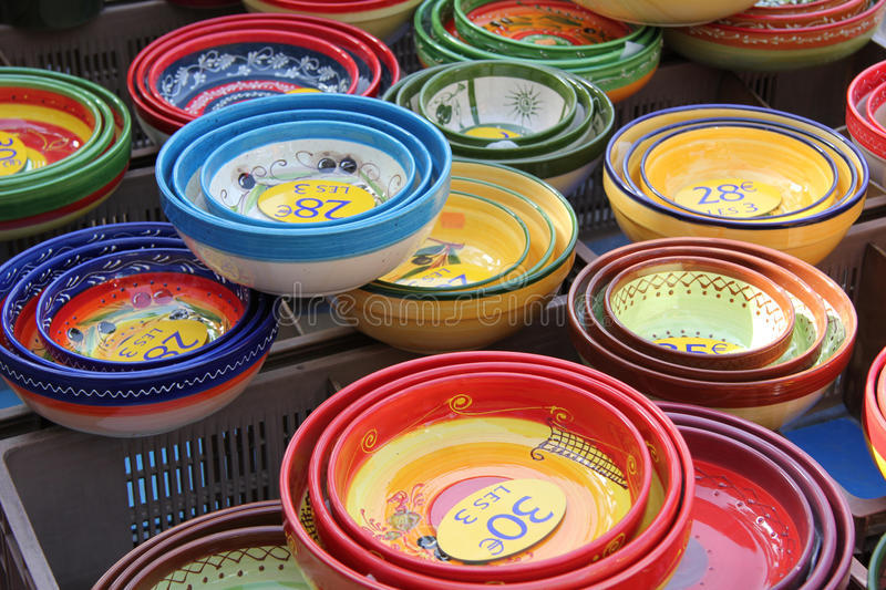 Provencal ceramics. Bowls in different sizes and patterns at a Provencal market in France stock photos