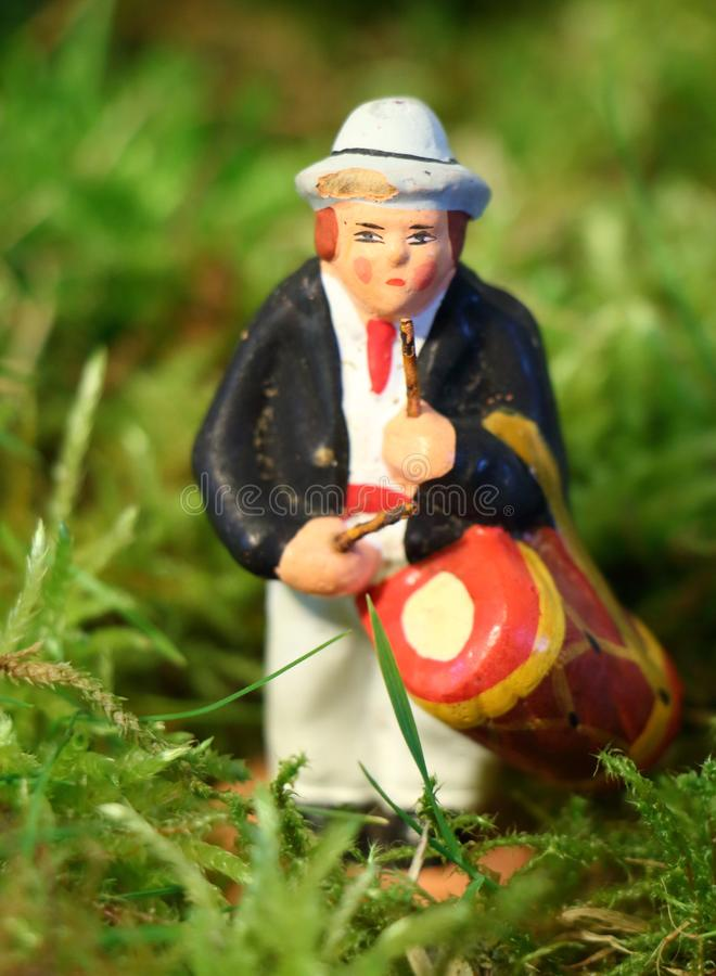 Provencal Christmas crib figure, the drummer. Provencal Christmas crib figure on moss, the drummer stock images