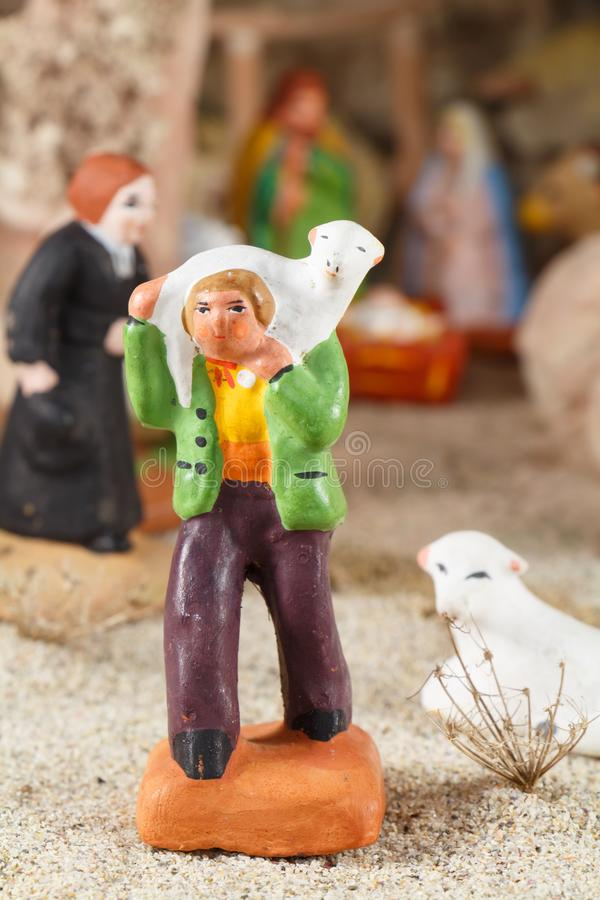 Provencal Christmas crib figure, the shepherd and sheep. Made in terracotta stock photography