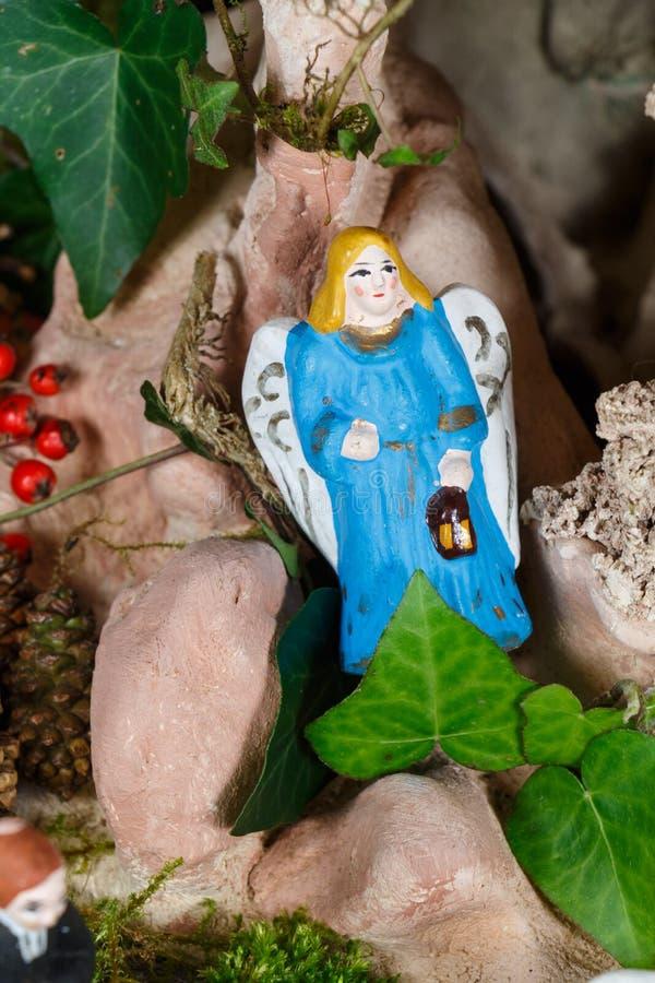 Provencal Christmas crib figure, the angel. Provencal Christmas crib figure in terracotta, the angel royalty free stock photography