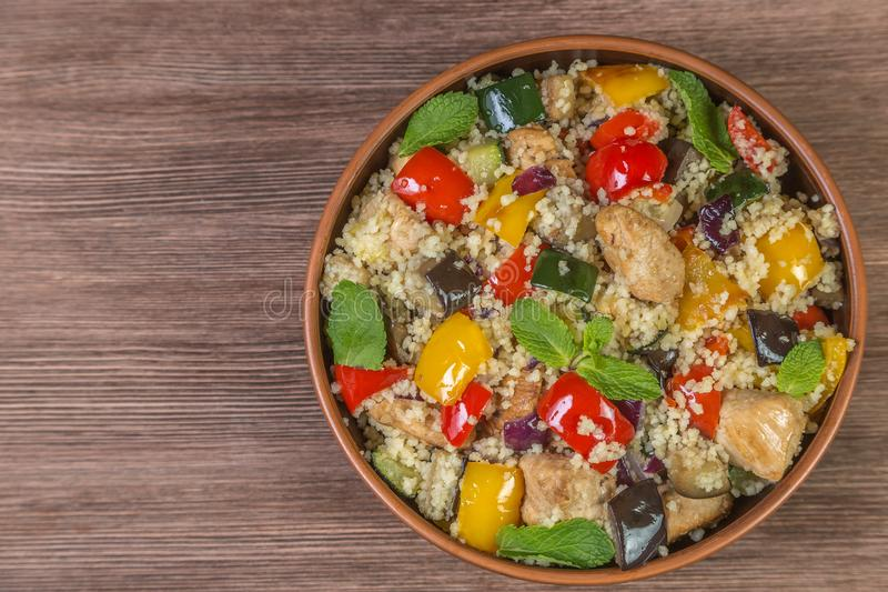 Provencal dish Ratatouille in a pot made of ceramics on the table made of oak planks. Brown. Proper nutrition and diet concept. Br stock photography