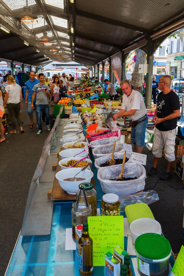 Provencal market in Cannes, French Riviera, France. Cannes, France - August 05, 2016: Provencal market in Cannes with unidentified people. Cannes is well known stock photo