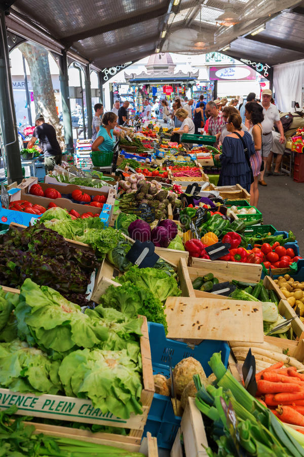 Provencal market in Cannes, French Riviera, France. Cannes, France - August 05, 2016: Provencal market in Cannes with unidentified people. Cannes is well known stock image