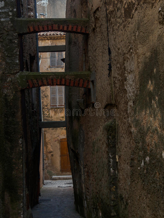 Provencal narrow street. Typical Provencal narrow street with supportive arc between buildings stock photography