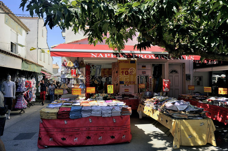 Provencal tablecloths and shop the colors of the Camargue. Region in the center of Saintes-Maries-de-la-Mer royalty free stock photo
