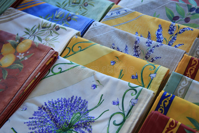 Provencal textile. In the colors and patterns of the Provence: yellow and blue with lavender and olive prints stock images