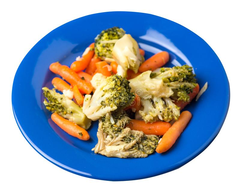Provencal vegetables on a plate.grilled vegetables on a plate isolated on white background.broccoli and carrots on a plate top. Provencal vegetables on a blue stock image