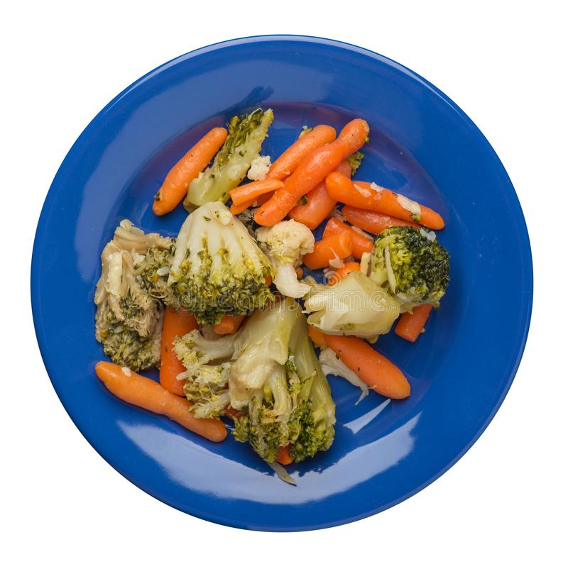 Provencal vegetables on a plate.grilled vegetables on a plate isolated on white background.broccoli and carrots on a plate top. Provencal vegetables on a blue stock photos