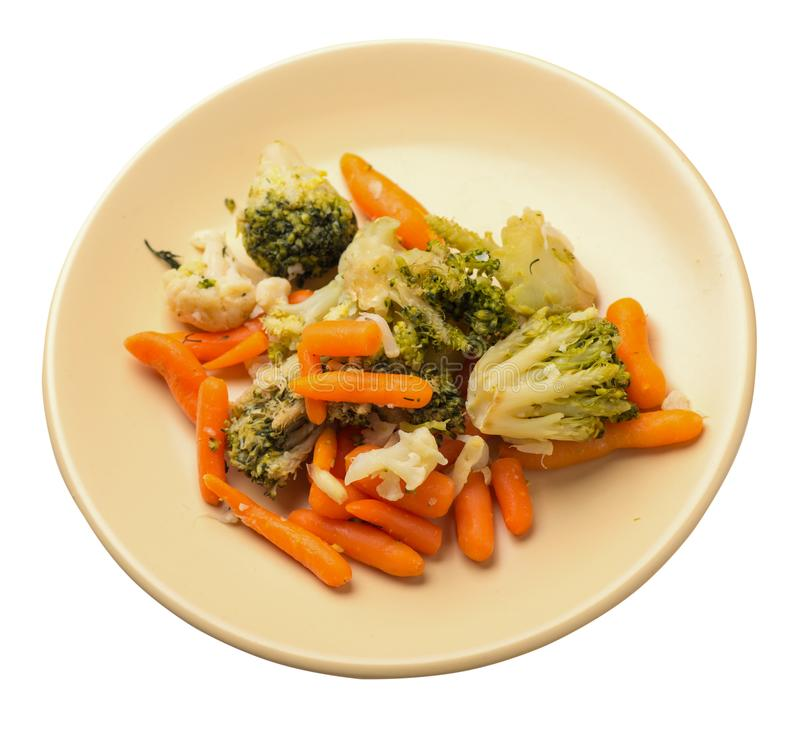 Provencal vegetables on a plate.grilled vegetables on a plate isolated on white background.broccoli and carrots on a plate top. Provencal vegetables on a light stock images