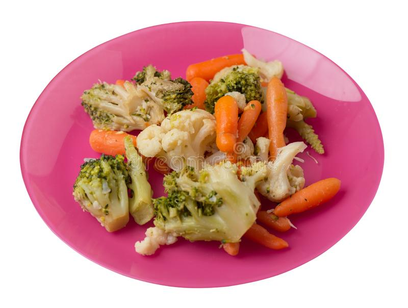 Provencal vegetables on a plate.grilled vegetables on a plate isolated on white background.broccoli and carrots on a plate top. Provencal vegetables on a pink royalty free stock photo