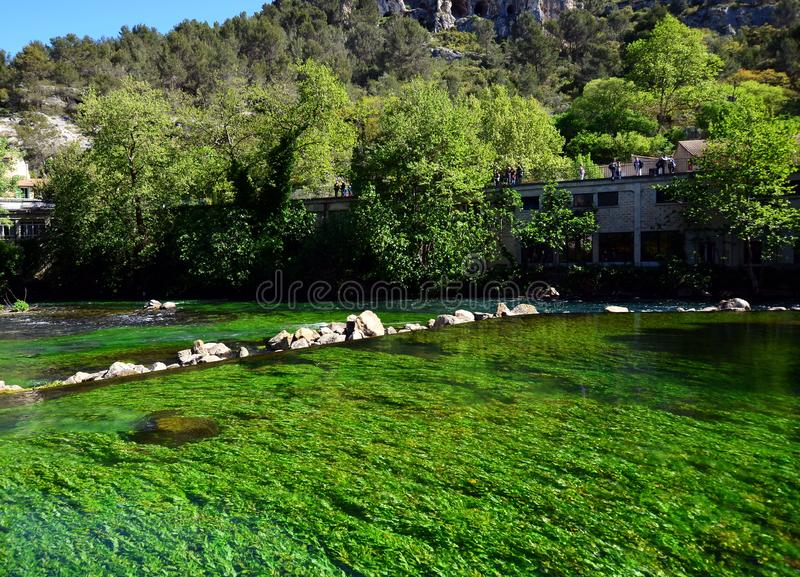 View on small touristic Provencal town with emerald green waters of Sorgue river. Provence in France. View on small touristic Provencal town with emerald green royalty free stock images